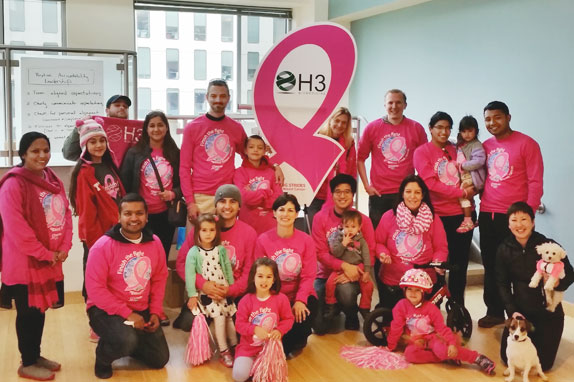 Group in pink clothing sponsored by H3